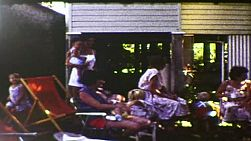 Party guests enjoying a child's birthday party in an Australian backyard, in 1983.  Film has been transferred using a frame-by-frame scan to produce the highest quality.