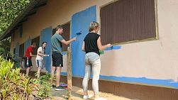 A group of high school students painting a Thai church located in the province of Chiang Rai, Thailand.