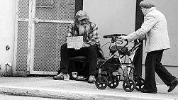 VANCOUVER, BC, OCTOBER 2015: An old homeless man living on the streets says hello to a stranger on the streets of Vancouver, BC.
