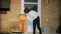 A mother checks on her jack o lantern prior to receiving kids trick or treating at Halloween in 1967.