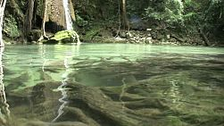 A low angle shot of beautiful Erawan Waterfalls in the western province of Kanchanaburi, Thailand.
