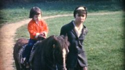 Kids enjoy going for a fun pony ride with their Dad encouraging them on in the summer of 1967.