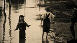 Kids explore their flooded neighborhood after the devastating floods of 1948 in Dallas, Texas.