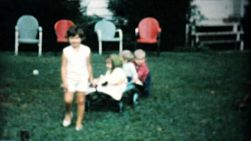 A group of children having fun in the backyard playing together and going for wagon rides in Akron, Ohio in the summer of 1961.