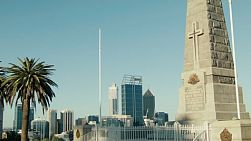 The State War Memorial in King's Park, Perth, Australia, with the city of Perth in the background, on a beautiful spring day.