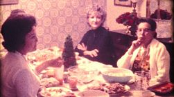 A beautiful family enjoys spending time celebrating Christmas together on December 25, 1974.