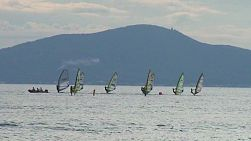 People learning to windsurf in Pattaya on the Gulf of Thailand.