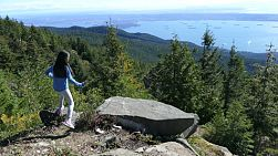 A cute little 10 year old Asian girl successfully climbs Cypress Mountain and Eagle Bluff look out with stunning views of the city of Vancouver on a gorgeous summer day.