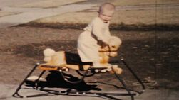 A cute little boy going crazy on his new rocking horse outside his home in the summer of 1964.