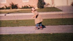 A cute little girl has fun rollerskating on her driveway in the spring of 1964.