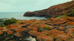 Looking across a rocky cape and coastline to the ocean in Western Australia.