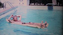 A man enjoys himself while floating on an air mattress in his pool while on holidays in Florida in 1969.