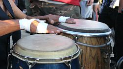 A young man plays his congas in the  drum circle on Venice Beach in beautiful Los Angeles, California.