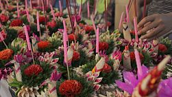 Decorative krathong rafts laid out ready to sell, at a stall during the Loi Krathong festival in Bangkok, Thailand.