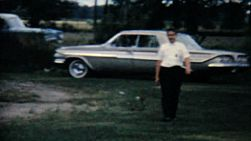 A proud man walks away from his brand new car in the summer of 1962.