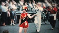 Several teenage marching bands pass by in the annual town parade in the fall of 1959.
