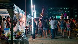 Food stalls at a concert during the Loi Krathong Festival in Thailand.