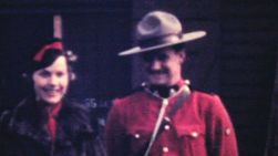 A tourist meets a member of the Royal Canadian Mounted Police (RCMP) in northern BC in 1940.