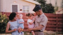 A beautiful young military family posing with their children during the summer of 1964.