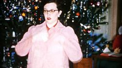 A pretty young mother gets a brand new pink jacket for Christmas in Cleveland, Ohio in 1956.