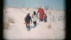 A mother enjoys sledding with his kids on a beautiful winter day in 1956.