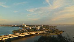View of the Narrows Bridge from King's Park, in Perth Australia. Traffic is crossing the bridge on the Kwinana Freeway in the golden evening sunlight.