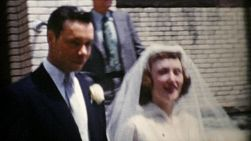 A happy newly married bride and groom leave the church and head to their wedding reception in 1967.