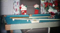 A family gets a new pool table for Christmas in Akron, Ohio in 1963.