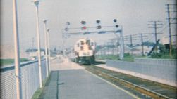 A new train slowly arrives in the station to pick up the passengers in the summer of 1967.