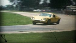 An odd looking yellow sports car speeds around the Car Rally circuit during the summer of 1975.