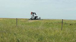 A faithful oil pump works tirelessly on a farm in the middle of the Canadian prairies.