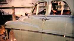Shots of an old 1950's Plymouth automobile in the American suburbs in 1958.