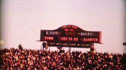 An old football score clock keeps score during the big college football game on New Year's Day in 1962.