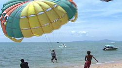 A parasailer takes off at the beach in Thailand.