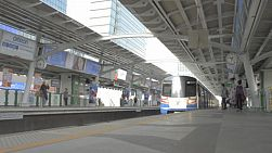 BANGKOK, THAILAND - OCTOBER 9 2013: A passenger train arriving at a skytrain station in Bangkok, Thailand.
