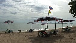 A lovely inviting beach scene just waiting for tourists to come and relax in Pattaya, Thailand.