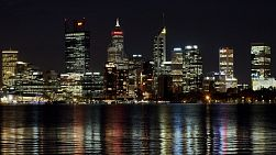 Perth, Australia - February 2020: Time lapse of the Perth CBD skyline at night, with the city lights reflecting on the Swan River.