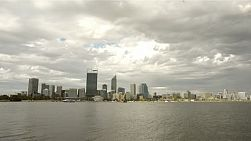 View of Perth City from across the Swan River on a cloudy summer day.