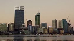 The skyline of the City of Perth in the light of dusk on a clear day.