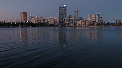 View of the City of Perth from across the Swan River, with the water and reflections covering most of the frame.