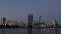 Dusk falls on the City of Perth, as seen from across the Swan River.