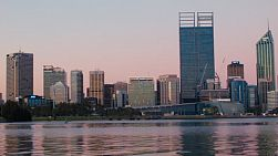 View of the City of Perth from across the Swan River, with the reflections on the water, in the dusk light on a spring evening.