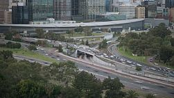 Evening time lapse of the Kwinana Freeway traffic and Perth Convention Centre.