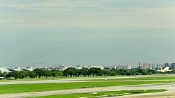 A plane taking off from the runway at Don Muang Airport, Bangkok, Thailand.