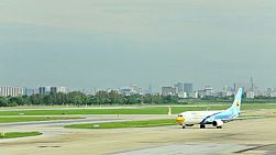 A plane taxiing on the runway at Don Muang Airport, Bangkok, Thailand.