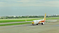 A Nok Air plane taxiing on a runway at Don Muang Airport, Bangkok, Thailand.