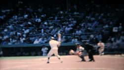 A batter hits the ball at a major league baseball game in New York in the summer of 1967.