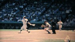 A batter takes some swings at the ball at a major league baseball game in New York in the summer of 1967.