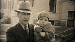 A proud handsome Grandpa holds his new grandson in the Fall of 1950.