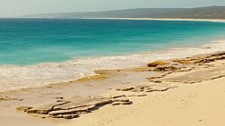 The beautiful water and rocky beach of Hamelin Bay in Australia's South West.